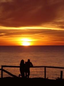 A couple enjoying a beautiful sunset